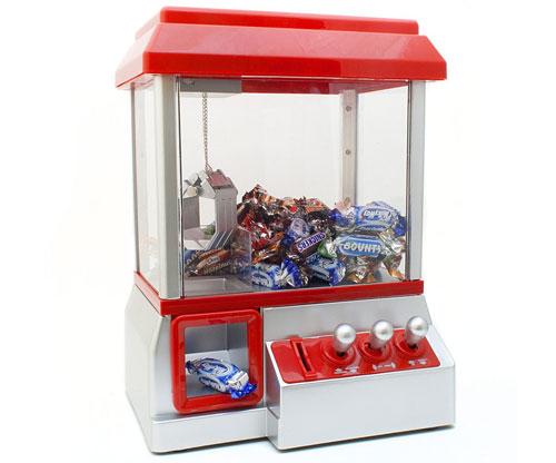 Spielautomat für Süßigkeiten/ Bonbons Greifmaschine/ Jahrmarkt mit Münzen